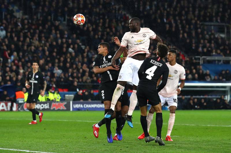 PARIS, FRANCE - MARCH 06:  Romelu Lukaku of Manchester United wins a header during the UEFA Champions League Round of 16 Second Leg match between Paris Saint-Germain and Manchester United at Parc des Princes on March 06, 2019 in Paris, . (Photo by Julian Finney/Getty Images)