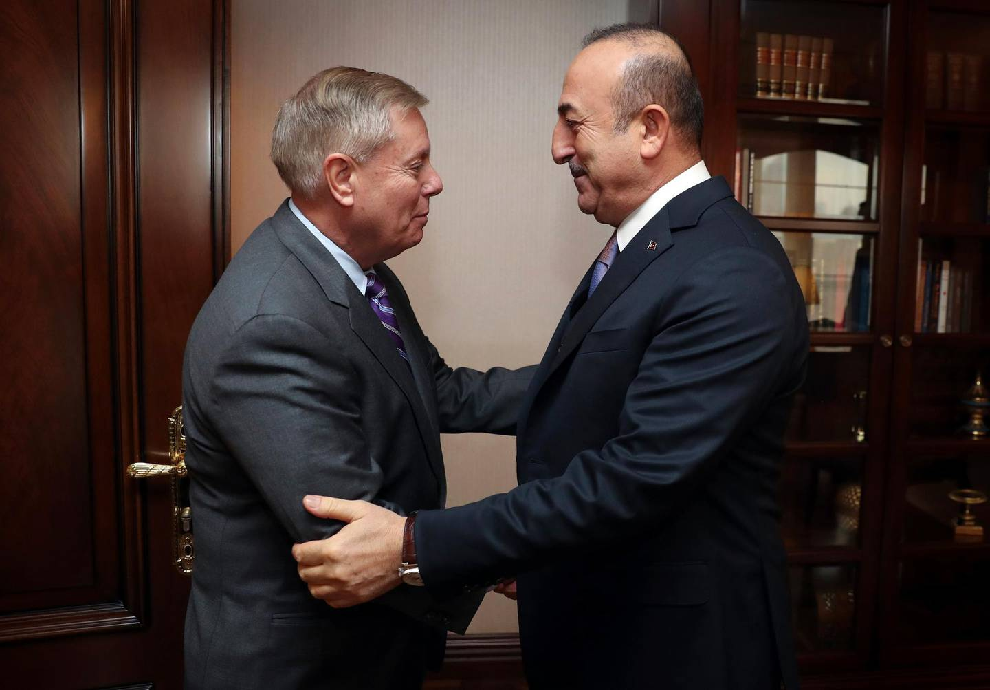 Turkey's Foreign Minister Mevlut Cavusoglu, right, and U.S. Republican Senator Lindsey Graham shake hands before a meeting in Ankara, Turkey, Friday, Jan. 18, 2019. Graham has discussed the situation in Syria with Cavusoglu and Turkey's President Recep Tayyip Erdogan as the United States prepares to withdraw troops.(Turkish Foreign Ministry Press Service via AP, Pool)