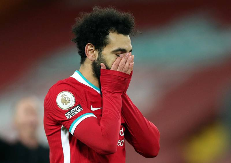 LIVERPOOL, ENGLAND - JANUARY 21: Mohamed Salah of Liverpool reacts during the Premier League match between Liverpool and Burnley at Anfield on January 21, 2021 in Liverpool, England. Sporting stadiums around the UK remain under strict restrictions due to the Coronavirus Pandemic as Government social distancing laws prohibit fans inside venues resulting in games being played behind closed doors. (Photo by Clive Brunskill/Getty Images)