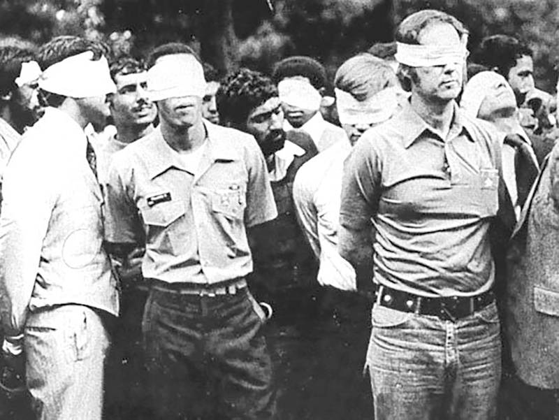 """FILE PHOTO: Blindfolded U.S. hostages and their Iranian captors outside the U.S. embassy in Tehran, Iran, 1979. U.S. Army/Handout via REUTERS/File Photo ATTENTION EDITORS - THIS IMAGE WAS PROVIDED BY A THIRD PARTY PLEASE SEARCH  """"FROM THE FILES -  IRAN MARKS 40TH ANNIVERSARY OF ISLAMIC REVOLUTION"""" FOR ALL PICTURES"""