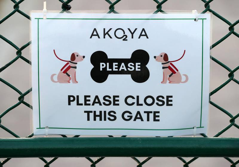 DUBAI, UNITED ARAB EMIRATES, December 10 – Message on the gate of Central Bark (dog park) in DAMAC Akoya Oxygen in Dubai. (Pawan Singh / The National) For Lifestyle/Online/Instagram. Story by Hayley
