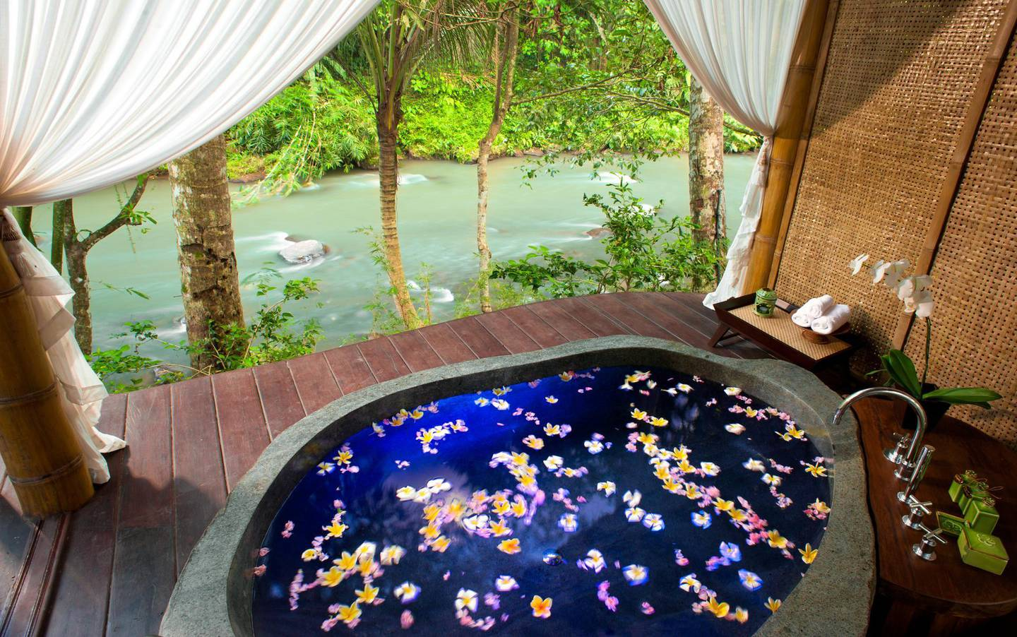 Each of the five residences at Fivelements features a private, hewn-boulder bath overlooking the Ayung River.