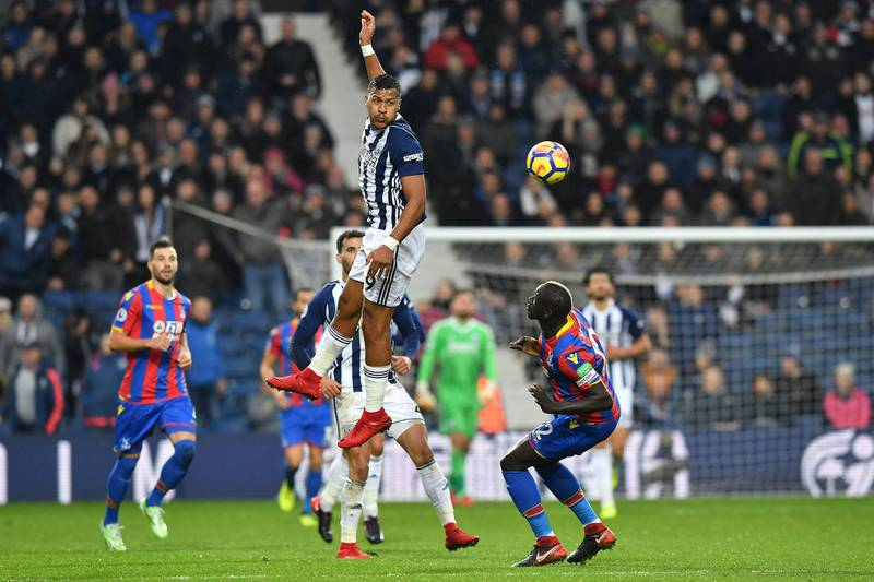 West Bromwich Albion's Venezuelan striker Salomon Rondon (C) vies with Crystal Palace's French midfielder Mamadou Sakho (R) during the English Premier League football match between West Bromwich Albion and Crystal Palace at The Hawthorns stadium in West Bromwich, central England, on December 2, 2017.  / AFP PHOTO / Ben STANSALL / RESTRICTED TO EDITORIAL USE. No use with unauthorized audio, video, data, fixture lists, club/league logos or 'live' services. Online in-match use limited to 75 images, no video emulation. No use in betting, games or single club/league/player publications.  /