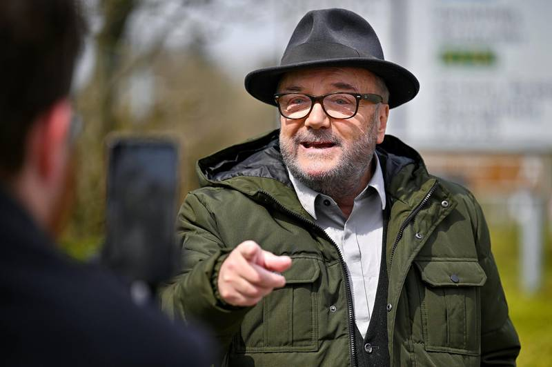 GRETNA GREEN, SCOTLAND - APRIL 20: George Galloway leader of the All For Unity Party campaigns during the Scottish Parliament election with a speech at the Gretna Gateway Outlet on April 20, 2021 in Gretna, Scotland. Mr Galloway visited Gretna with his wife Gayatri, where he gave a speech slamming First Minister Nicola Sturgeon's handling of the Coronavirus pandemic. (Photo by Jeff J Mitchell/Getty Images)