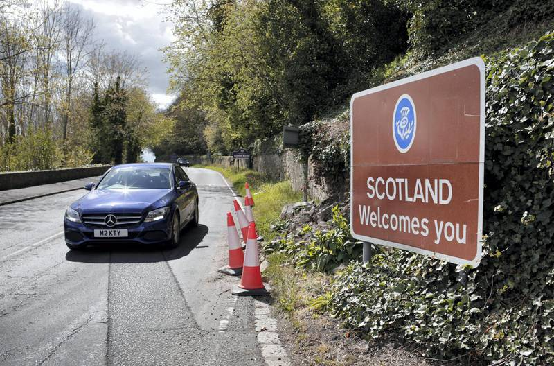 A 'Scotland Welcomes You' sign on the approach to Coldstream. Photograph: Stuart Boulton