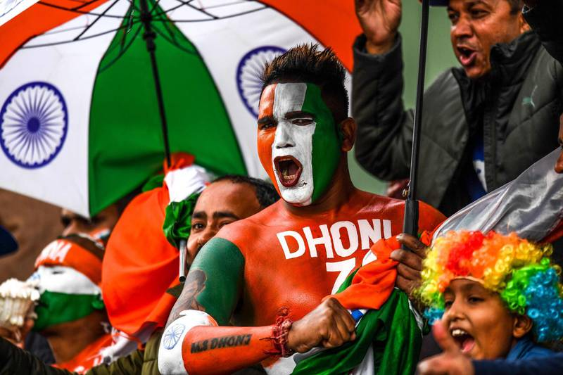 A cricket fan painted with the colours of the Indian national flag on his body cheers during the first one day international (ODI) cricket match of a three-match series between India and South Africa at Himachal Pradesh Cricket Association Stadium in Dharamsala on March 12, 2020. ----IMAGE RESTRICTED TO EDITORIAL USE - STRICTLY NO COMMERCIAL USE-----  / AFP / Sajjad  HUSSAIN / ----IMAGE RESTRICTED TO EDITORIAL USE - STRICTLY NO COMMERCIAL USE-----