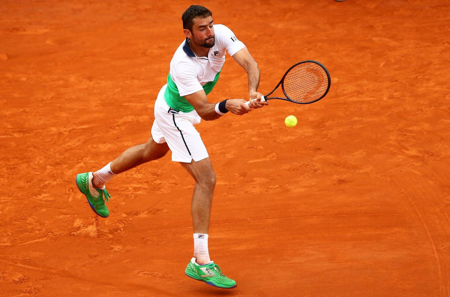 MONTE-CARLO, MONACO - APRIL 16: Marin Cilic of Croatia plays a backhand against Guido Pella of Argentina in their second round match during day 3 of the Rolex Monte-Carlo Masters at Monte-Carlo Country Club on April 16, 2019 in Monte-Carlo, Monaco. (Photo by Clive Brunskill/Getty Images)