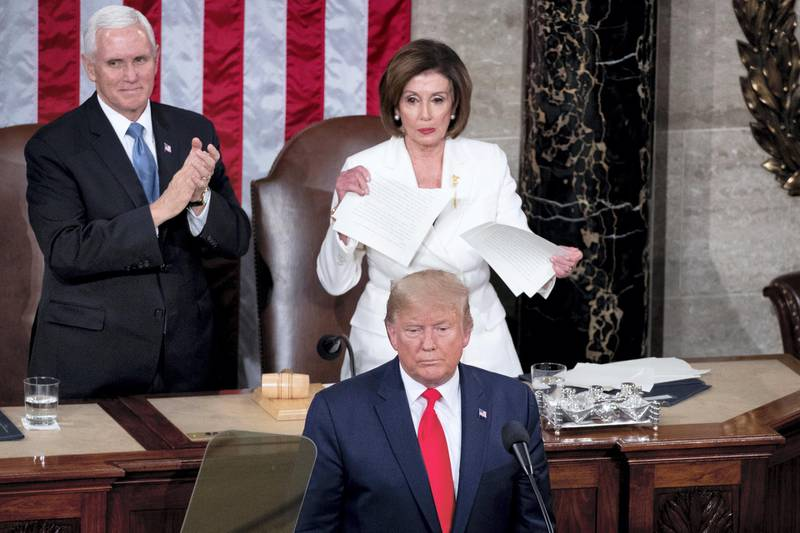 epa08939632 (FILE) Speaker of the House Nancy Pelosi (C, top) tears up a copy of the State of the Union address that US President Donald J. Trump (C, bottom) just delivered, as US Vice President Mike Pence (L) looks on, in front of the floor of the US House of Representatives on Capitol Hill in Washington, DC, USA, 04 February 2020. The presidency of Donald Trump, which records two presidential impeachments, will end at noon on 20 January 2021.  EPA-EFE/MICHAEL REYNOLDS *** Local Caption *** 56621646