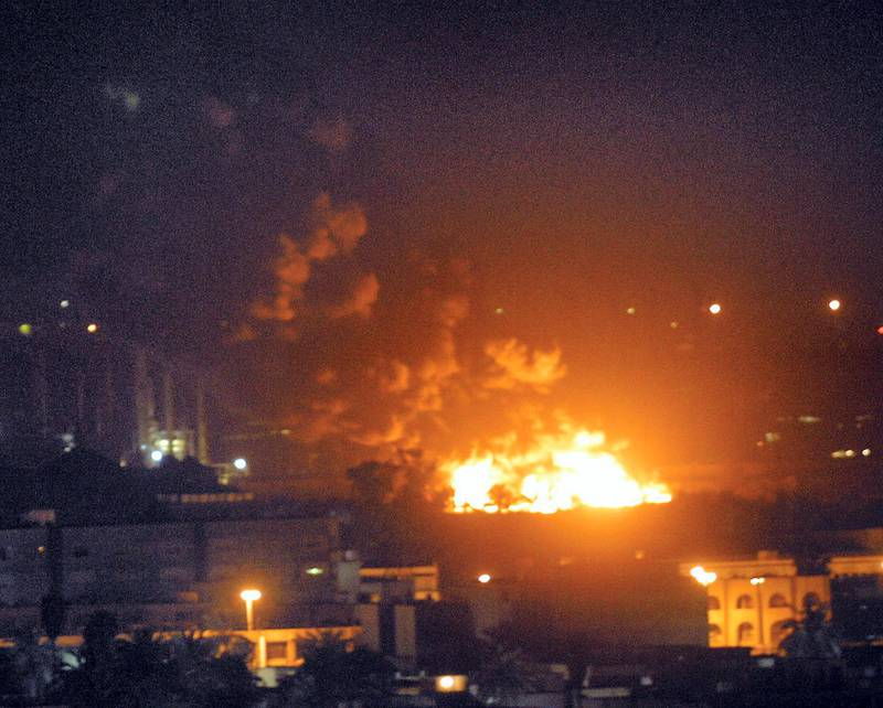 A park catches fire during a US strike on a presidential palace in Baghdad late 22 March 2003. The Iraqi capital came under heavy bombardment for the third consecutive night.      AFP PHOTO/Karim SAHIB (Photo by KARIM SAHIB / AFP)
