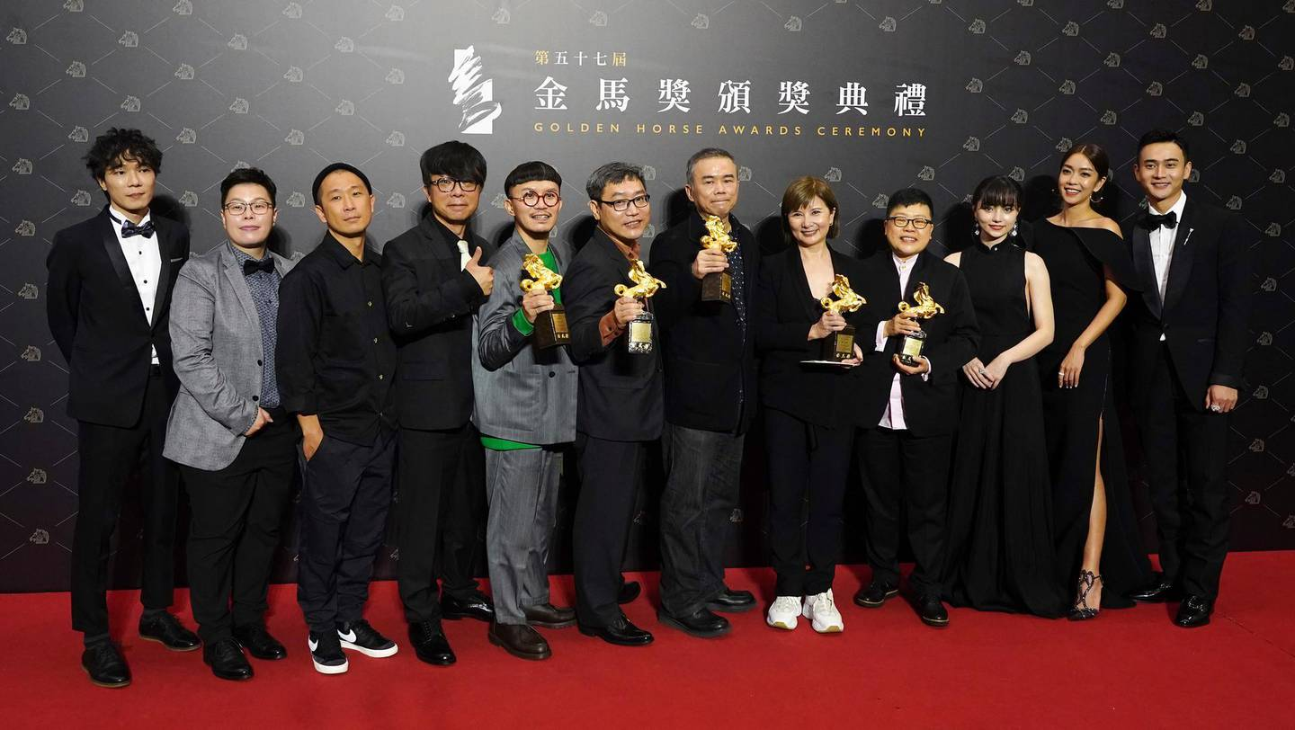 """Team members of movie """"My Missing Valentine"""" hold their awards for press at the 57th Golden Horse Awards in Taipei, Taiwan, Saturday, Nov. 21, 2020. Golden Horse Awards is considered Asia's equivalent of the Academy Awards for Chinese-language films. (AP Photo/Billy Dai)"""