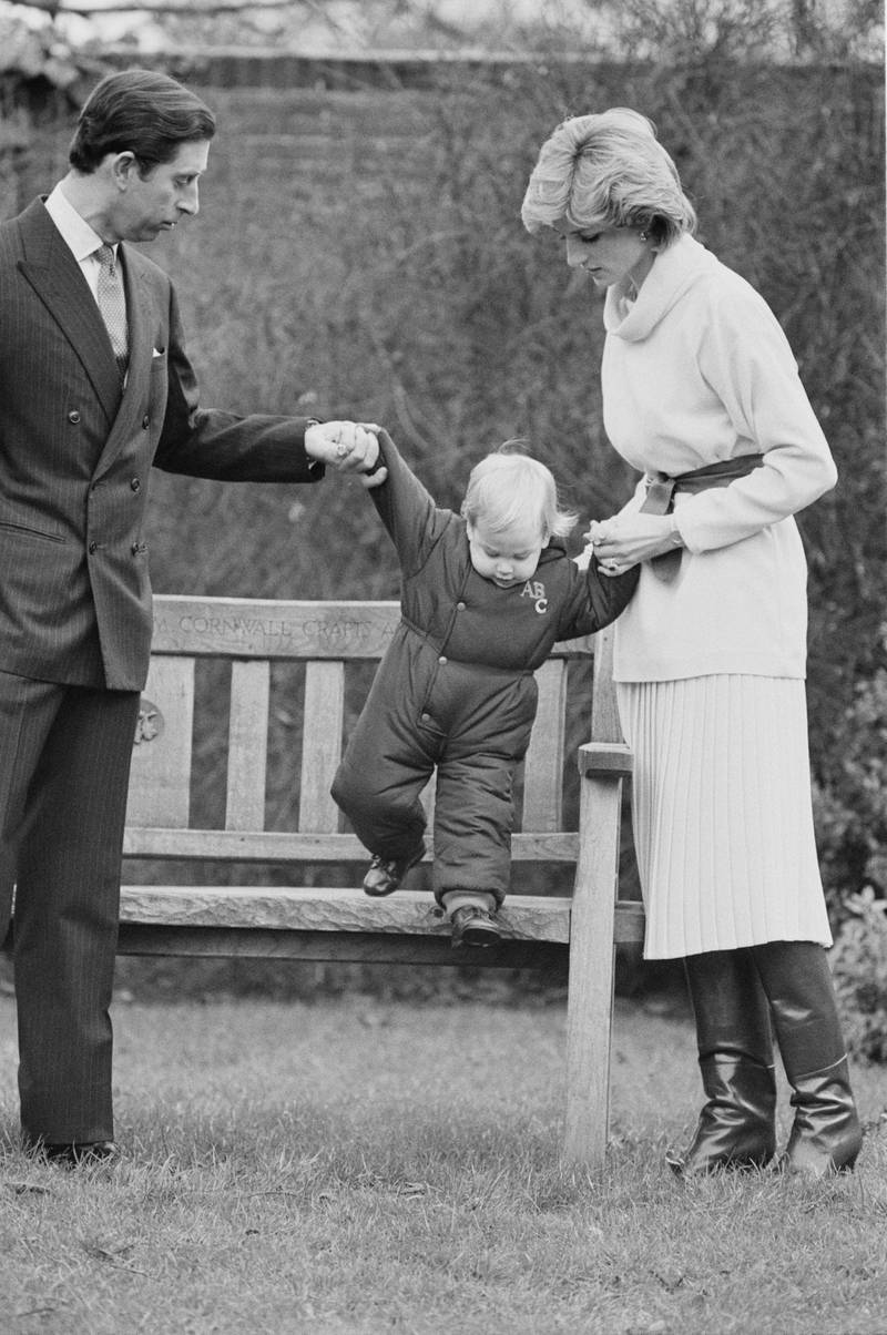 Charles, Prince of Wales, and Diana, Princess of Wales (1961 - 1997) with their son Prince William, Duke of Cambridge, UK, 14th December 1983. (Photo by Daily Express/Hulton Archive/Getty Images)