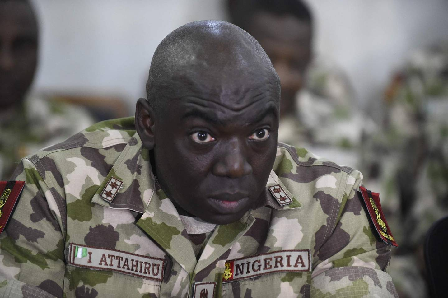 (FILES) In this file photo taken on October 04, 2017 Commander of the Operation Lafiya Dole Major General Ibrahim Attahiru speaks at the army headquarters, in Maiduguri, Borno State in northcentral Nigeria.  Nigeria's top-ranking army commander General Ibrahim Attahiru was killed on on May 21, 2021 when his plane crashed in the country's north, an air force spokesman said. Attahiru was appointed by President Muhammadu Buhari in January in a shakeup of the top military command to better fight surging violence and a more than decade-long jihadist insurgency. / AFP / PIUS UTOMI EKPEI