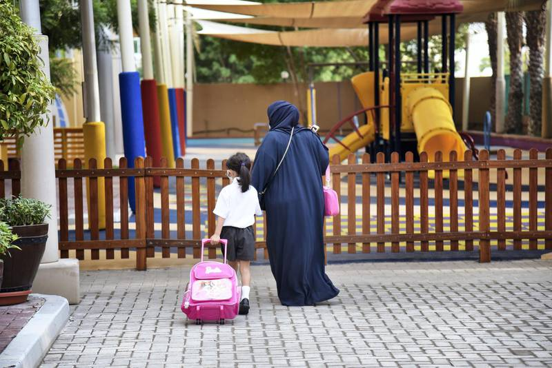 An Emirati woman walks with her daughter at the Al-Mizhar American Academy as the government re-opens schools after months in the wake of Covid-19 pandemic in Dubai, UAE, Sunday, Aug. 30, 2020. (Photos by Shruti Jain - The National)