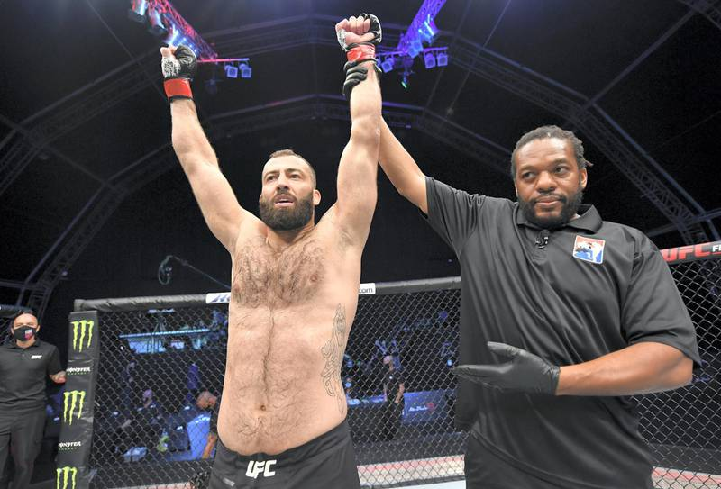 ABU DHABI, UNITED ARAB EMIRATES - JULY 19: Roman Dolidze of Georgia celebrates after his knockout victory over Khadis Ibragimov in their light heavyweight bout during the UFC Fight Night event inside Flash Forum on UFC Fight Island on July 19, 2020 in Yas Island, Abu Dhabi, United Arab Emirates. (Photo by Jeff Bottari/Zuffa LLC via Getty Images) *** Local Caption *** ABU DHABI, UNITED ARAB EMIRATES - JULY 19: Roman Dolidze of Georgia celebrates after his knockout victory over Khadis Ibragimov in their light heavyweight bout during the UFC Fight Night event inside Flash Forum on UFC Fight Island on July 19, 2020 in Yas Island, Abu Dhabi, United Arab Emirates. (Photo by Jeff Bottari/Zuffa LLC via Getty Images)