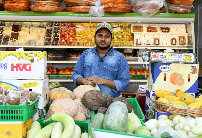 Residents and Heat in Sweihan-AD  Abdullah Ok, 21 from India, owner of Red Apple Fruits and Vegetables Sales in Sweihan, on June 9, 2021. Reporter: Haneen Dajani News