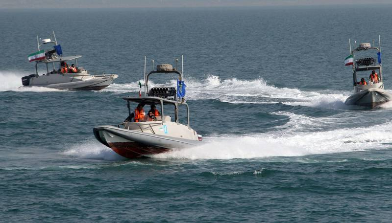 (FILES) In this file photo taken on July 2, 2012, members of Iran's Islamic Revolutionary Guard Corps (IRGC) ride in speed boats during a ceremony to commemorate the 24th anniversary of the downing of Iran Air flight 655 by the US navy, at the port of Bandar Abbas. Iran on September 16 seized a boat suspected of being used to smuggle fuel, and arrested its 11 crew members near the vital Strait of Hormuz oil shipping lane, state television reported. A naval patrol of the IRGC intercepted the vessel carrying 250,000 litres of fuel, state TV's website said, citing a commander of the force. / AFP / ATTA KENARE