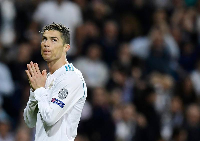(FILES) In this file photo taken on May 01, 2018 Real Madrid's Portuguese forward Cristiano Ronaldo gestures during the UEFA Champions League semi-final second leg football match between Real Madrid and Bayern Munich at the Santiago Bernabeu Stadium in Madrid on May 1, 2018. Cristiano Ronaldo agreed on June 15, 2018 to pay 18.8 million euros to the Spanish treasury, said a judiciary source.  / AFP / JAVIER SORIANO