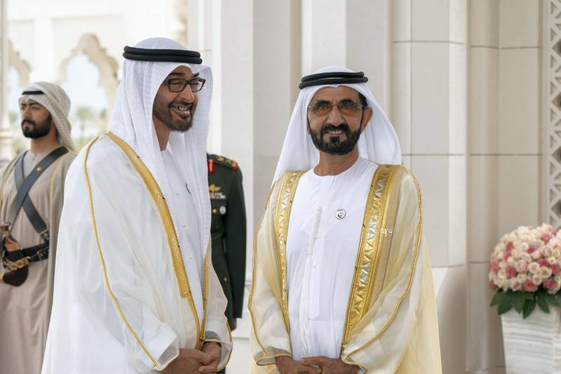 ABU DHABI, UNITED ARAB EMIRATES - February 04, 2019: Day two of the UAE papal visit - HH Sheikh Mohamed bin Zayed Al Nahyan, Crown Prince of Abu Dhabi and Deputy Supreme Commander of the UAE Armed Forces (L) hosts a reception for His Holiness Pope Francis, Head of the Catholic Church (not shown) at the Presidential Palace. Seen with HH Sheikh Mohamed bin Rashid Al Maktoum, Vice-President, Prime Minister of the UAE, Ruler of Dubai and Minister of Defence (R).  ( Mohamed Al Hammadi / Ministry of Presidential Affairs ) ---