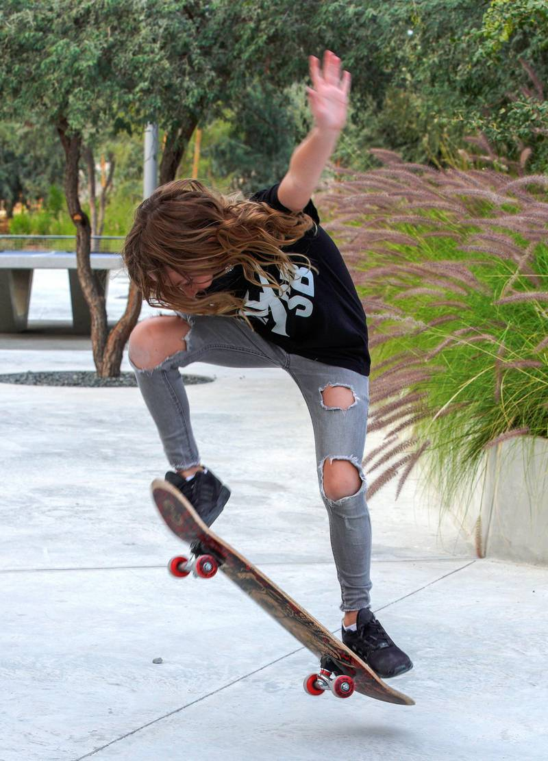 Abu Dhabi, United Arab Emirates, January 21, 2021.  Anabelle does some tricks on her scateboard at Al Fay Park on Reem Island. Victor Besa/The National  Section:  LF Reporter: Panna Munyal
