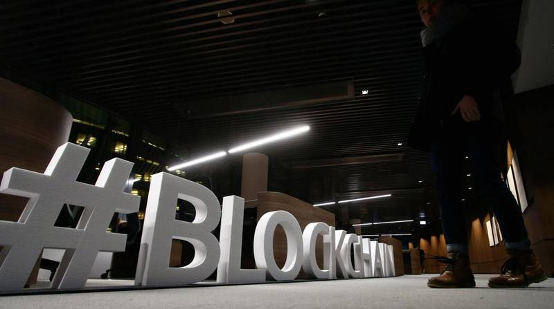 """Giant letters, reading the word """"blockchain"""", are displayed at the blockchain centre, which aims at boosting start-ups, on February 7, 2018 in Lithuania's capital Vilnius. Britain's divorce with the European Union is paying off for Lithuania as it strives to become a northern European hub for financial technology, or """"fintech"""" firms, and blockchain-based start-ups. European Parliament member and entrepreneur Antanas Guoga launched the blockchain centre in Vilnius to boost start-ups and establish connections with Asia and Australia. / AFP PHOTO / Petras Malukas"""
