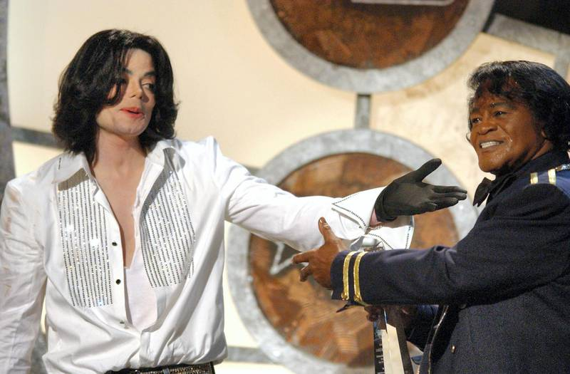 Michael Jackson gives James Brown his Lifetime Achievement Award (Photo by M. Caulfield/WireImage for BET Entertainment)