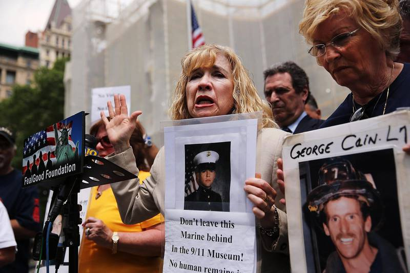 (FILES) In this file photo taken on May 26, 2014, Sally Regenhard, who lost her son on 9/11, speaks at a news conference with other family members on the steps of City Hall to criticize the placement of unidentified human remains beneath the newly opened National September 11 Memorial and Museum in New York City. - Seventeen years later, more than 1,100 victims of the hijacked plane attacks on the World Trade Center have yet to be identified. But in a New York lab, a team is still avidly working to identify the remains, with technological progress on its side. Day in, day out, they repeat the same protocol dozens of times. (Photo by SPENCER PLATT / GETTY IMAGES NORTH AMERICA / AFP)