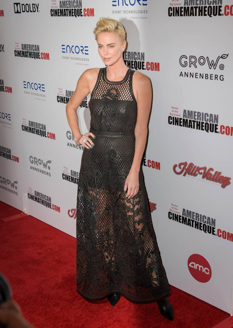 epa07982546 South African actress Charlize Theron poses for photographers upon her arrival for the American Cinematheque 2019 Award Show at the Beverly Hilton in Los Angeles, California, USA, 08 November 2019.  EPA-EFE/CHRISTIAN MONTERROSA