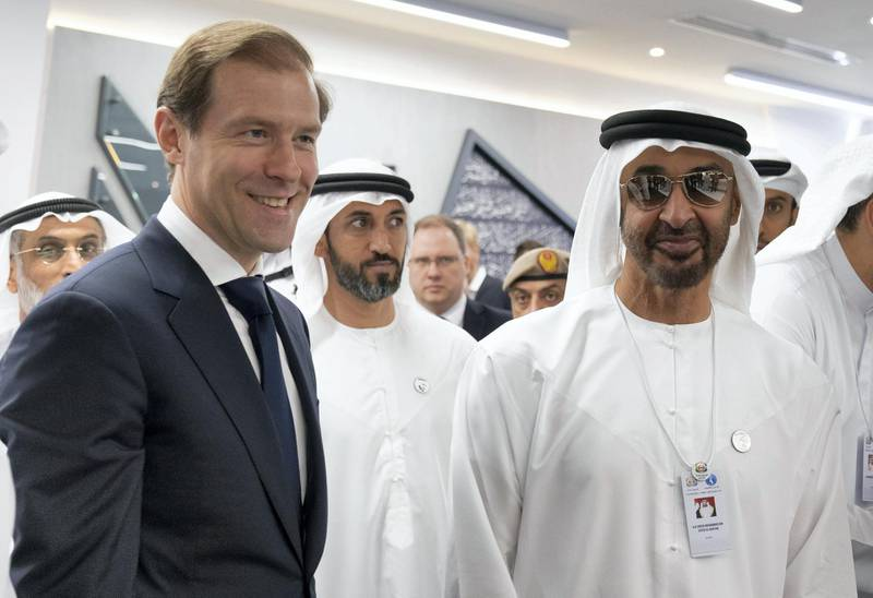ABU DHABI, UNITED ARAB EMIRATES - February 18, 2019:  HH Sheikh Mohamed bin Zayed Al Nahyan, Crown Prince of Abu Dhabi and Deputy Supreme Commander of the UAE Armed Forces (R) meets with Denis Manturov, Minister of Industry and Trade of the Russian Federation (L), at the Aurus stand during the 2019 International Defence Exhibition and Conference (IDEX), at Abu Dhabi National Exhibition Centre (ADNEC).  ( Ryan Carter / Ministry of Presidential Affairs ) ---