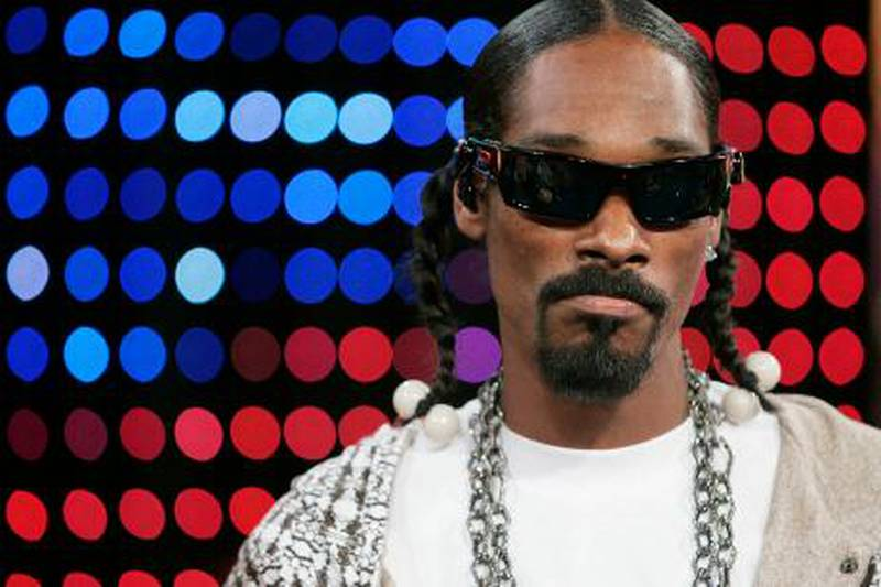 **FILE** Hip hop artist Snoop Dogg appears on stage during MTV's 'Total Request Live' show at the MTV Times Square Studios, in this Nov. 14, 2006, file photo in New York. Snoop Dogg pleaded not guilty Wednesday, Jan. 24, 2006 to a charge of possessing a deadly weapon, a collapsible police baton found in his luggage at an airport.  (AP Photo/Jeff Christensen, file)