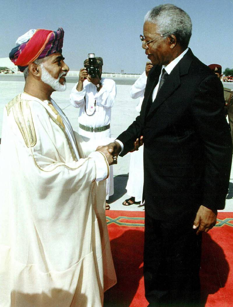 Omani Sultan Qaboos (L) greets South African President Nelson Mandela 06 April 1999 upon his arrival in Muscat at the start of a short tour of the Gulf to promote investments in South Africa. The 80-year-old South African leader is on one of his last official visits abroad before stepping down after the 02 June 1999 elections. (Photo by AFP)