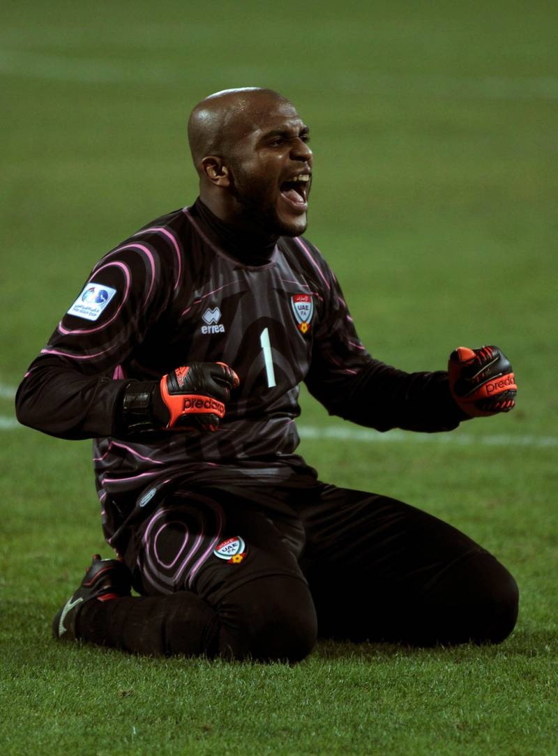United Arab Emirates goal keeper Ali khussef Hamid celebrates his team second goal against Iraq in the Gulf Cup final Friday, Jan. 18, 2013, in Rifa, Bahrain. United Arab Emirates beat Iraq 2-1 in extra time on Friday to claim its second Gulf Cup title. (AP Photo/Hasan Jamali) *** Local Caption ***  Bahrain Gulf Cup.JPEG-0de53.jpg
