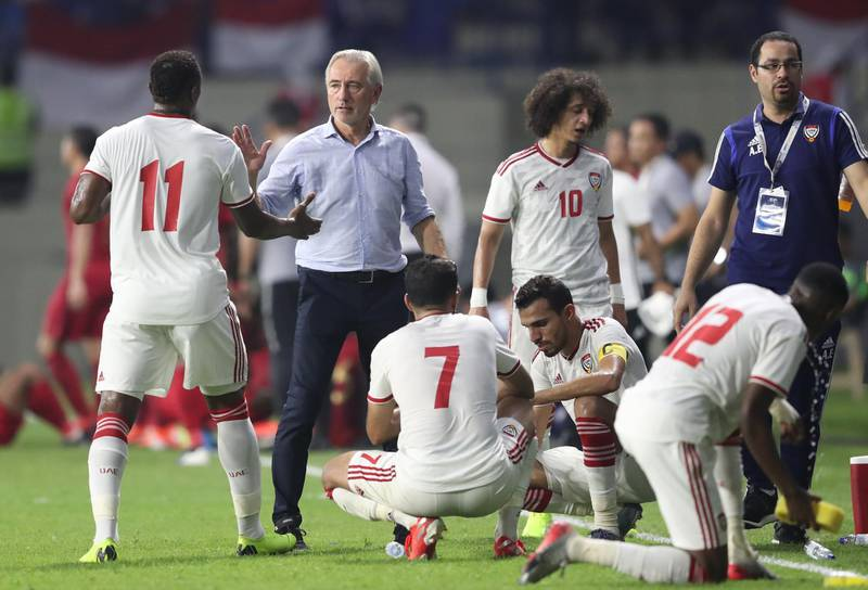 epa07911017 Bert van Marwijk (2-L), head coach of UAE,  reacts during the FIFA World Cup 2022 and AFC Asian Cup 2023 qualifier soccer match group G between UAE and Indonesia in Dubai, United Arab Emirates on 10 October 2019.  EPA/ALI HAIDER