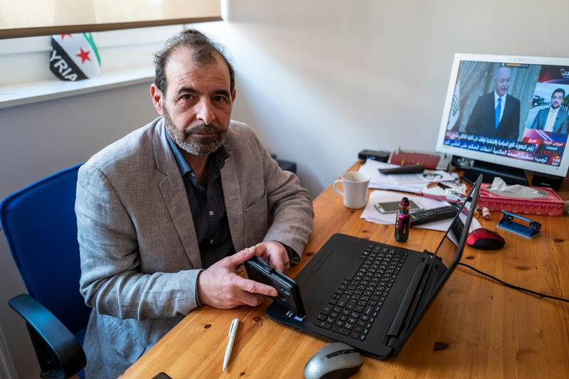 Syrian human rights lawyer Anwar al-Bunni poses in his office in Berlin on April 9, 2020. - When Anwar al-Bunni crossed paths with fellow Syrian Anwar Raslan in a DIY store in Germany five years ago, he recognised him as the man who had thrown him into prison around a decade earlier. On Thursday, April 23, 2020 the two men will face each other in a German court, where Raslan will be one of two alleged former Syrian intelligence officers in the dock accused of carrying out crimes against humanity for Bashar al-Assad's regime. (Photo by John MACDOUGALL / AFP)