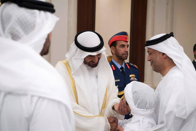 ABU DHABI, UNITED ARAB EMIRATES - June 15, 2018: HH Sheikh Mohamed bin Zayed Al Nahyan Crown Prince of Abu Dhabi Deputy Supreme Commander of the UAE Armed Forces (C), greets a young guest during an Eid Al Fitr reception at Mushrif Palace.   ( Saeed Al Neyadi / Crown Prince Court - Abu Dhabi ) ---