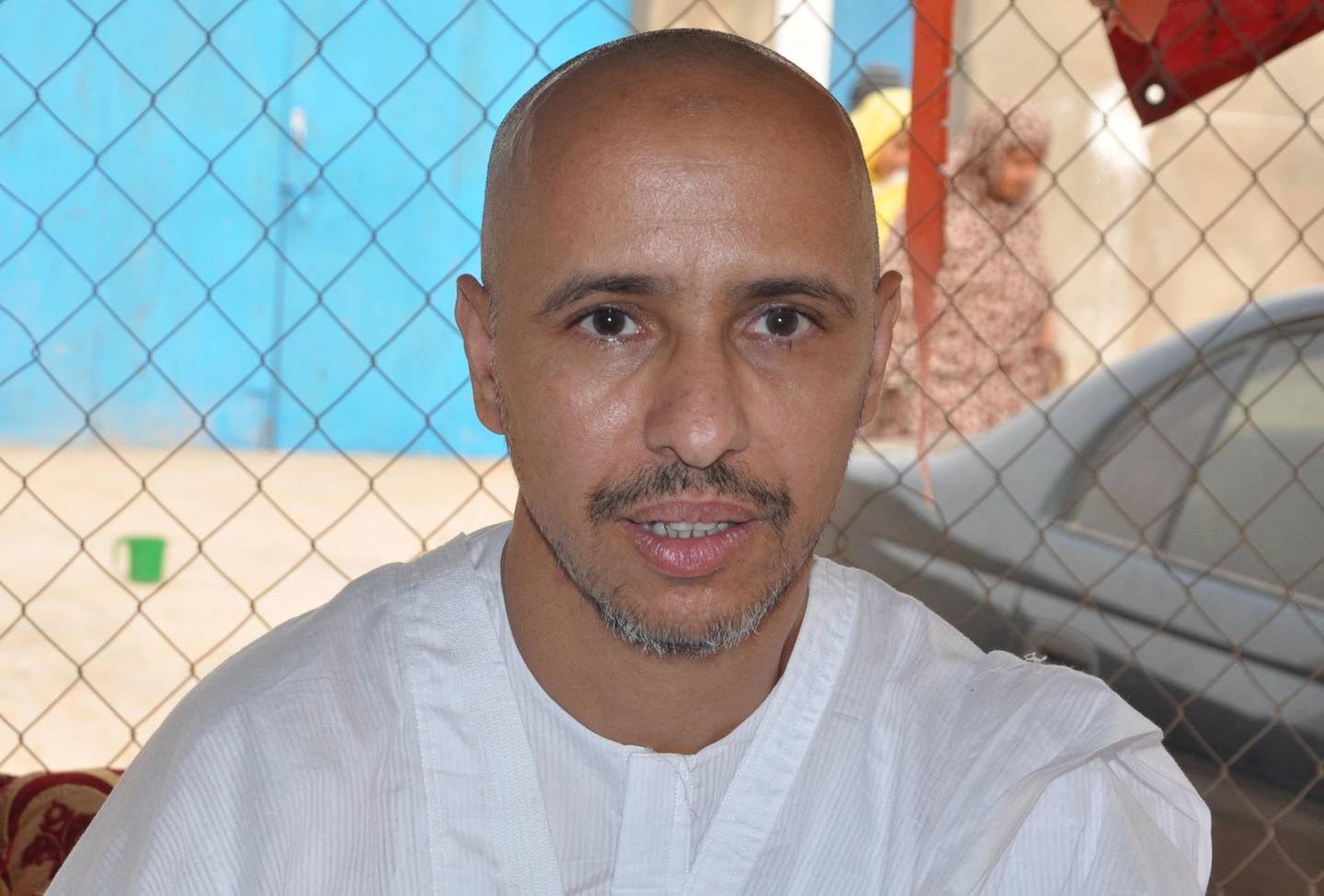 """Mohamedou Ould Slahi, a Guantanamo Bay prisoner who wrote a best-selling book about his experiences in the military prison, poses on October 18, 2016 in Nouakchott, after he was reunited with his family in his native Mauritania on October 17 after 14 years of detention - The transfer of Mohamedou Ould Slahi, believed to be the last inmate from Mauritania held at the facility in Cuba, brings the prison's remaining population down to 60. His case became a cause celebre after the publication last year of """"Guantanamo Diary"""", in which he outlines his treatment at the notorious US naval base in Cuba and says he was subjected to torture. (Photo by STRINGER / AFP)"""
