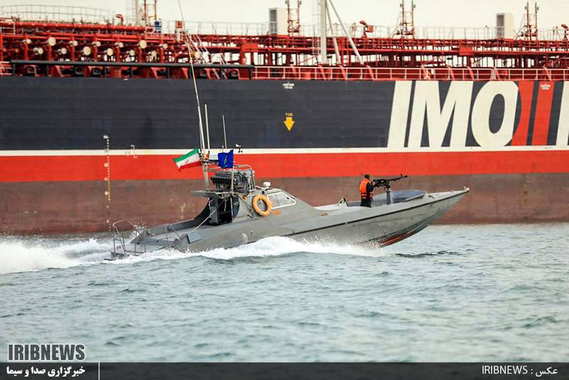 """(FILES) In this file photo taken on July 22, 2019, an image grab taken from a broadcast by Islamic Republic of Iran Broadcasting (IRIB), shows Iranian Revolutionary Guards in speedboats patrolling a tanker Stena Impero as it's anchored off the Iranian port city of Bandar Abbas. A US vessel fired warning shots at more than a dozen Iranian fast attack boats which buzzed close to a US Navy submarine and escort ships in the narrow Strait of Hormuz on May 10, 2021, the Pentagon said. / AFP / IRIB / - / RESTRICTED TO EDITORIAL USE - MANDATORY CREDIT """"AFP PHOTO / HO / IRIB"""" - NO MARKETING NO ADVERTISING CAMPAIGNS - DISTRIBUTED AS A SERVICE TO CLIENTS  /NO RESALE/ NO ACCESS ISRAEL MEDIA/PERSIAN LANGUAGE TV STATIONS/ OUTSIDE IRAN/ STRICTLY NI ACCESS BBC PERSIAN/ VOA PERSIAN/ MANOTO-1 TV/ IRAN INTERNATIONAL"""""""