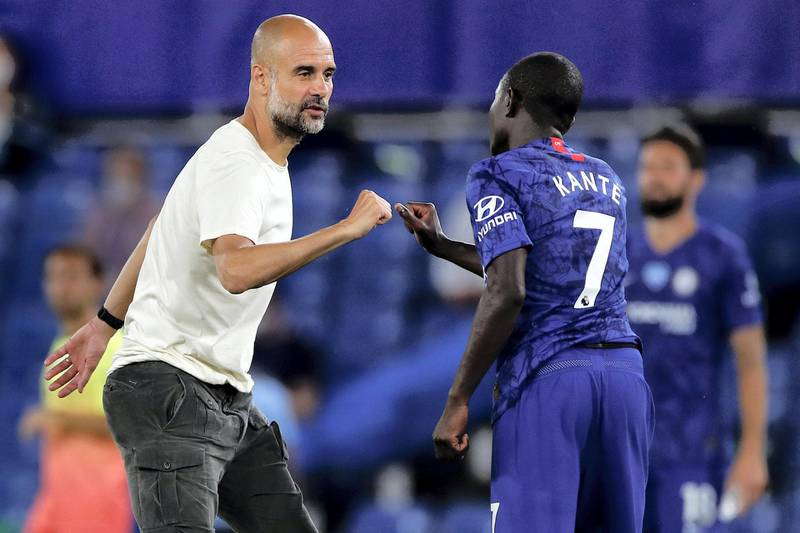 Manchester City's Spanish manager Pep Guardiola elbow bumps with Chelsea's French midfielder N'Golo Kante after the English Premier League football match between Chelsea and Manchester City at Stamford Bridge in London on June 25, 2020. - Cheslea won the match 2-1. Jurgen Klopp's legendary status at Anfield was secured on Thursday as he became the first Liverpool manager to win a league title in 30 years. (Photo by PAUL CHILDS / POOL / AFP) / RESTRICTED TO EDITORIAL USE. No use with unauthorized audio, video, data, fixture lists, club/league logos or 'live' services. Online in-match use limited to 120 images. An additional 40 images may be used in extra time. No video emulation. Social media in-match use limited to 120 images. An additional 40 images may be used in extra time. No use in betting publications, games or single club/league/player publications. /