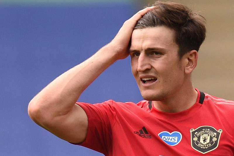 """(FILES) In this file photo taken on July 26, 2020 Manchester United's English defender Harry Maguire reacts during the English Premier League football match between Leicester City and Manchester United at King Power Stadium in Leicester, central England. Manchester United and England defender Harry Maguire said on August 27, 2020 he was """"scared"""" for his life and thought he was the victim of a kidnapping when he was arrested on a Greek holiday island. - RESTRICTED TO EDITORIAL USE. No use with unauthorized audio, video, data, fixture lists, club/league logos or 'live' services. Online in-match use limited to 120 images. An additional 40 images may be used in extra time. No video emulation. Social media in-match use limited to 120 images. An additional 40 images may be used in extra time. No use in betting publications, games or single club/league/player publications.  / AFP / POOL / Oli SCARFF                           / RESTRICTED TO EDITORIAL USE. No use with unauthorized audio, video, data, fixture lists, club/league logos or 'live' services. Online in-match use limited to 120 images. An additional 40 images may be used in extra time. No video emulation. Social media in-match use limited to 120 images. An additional 40 images may be used in extra time. No use in betting publications, games or single club/league/player publications."""
