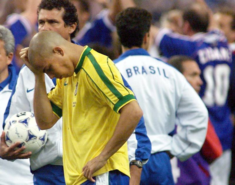 Brazilian forward Ronaldo looks dejected 12 July at the Stade de France in Saint-Denis, near Paris, after the 1998 Soccer World Cup final matchvs Brazil. France won the title for the first time beating Brazil 3-0. (ELECTRONIC IMAGE) AFP PHOTO ANTONIO SCORZA / AFP PHOTO / ANTONIO SCORZA