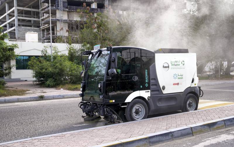 Abu Dhabi, United Arab Emirates, March 27, 2020.  A Tadweer stret sweeper vehicle in action at the Plant Market on the first day of the UAE cleaning campaign.  Emiratis and residents across the UAE must stay home this weekend while a nationwide cleaning and sterilisation drive is carried out. Victor Besa / The National