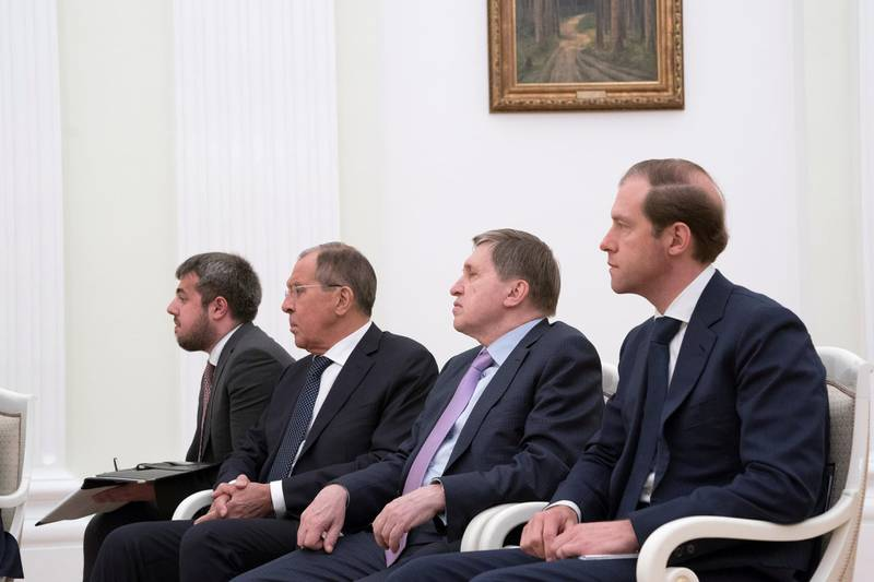 MOSCOW, RUSSIA - June 01, 2018:  HE Sergey Lavrov Minister of Foreign Affairs of Russia (3rd R) and HE Denis Manturov, Minister of Industry and Trade of Russia (R), attend a meeting with HE Vladimir Putin Vladimirovich, President of Russia (not shown), at the Kremlin Palace.  ( Mohamed Al Hammadi / Crown Prince Court - Abu Dhabi ) ---