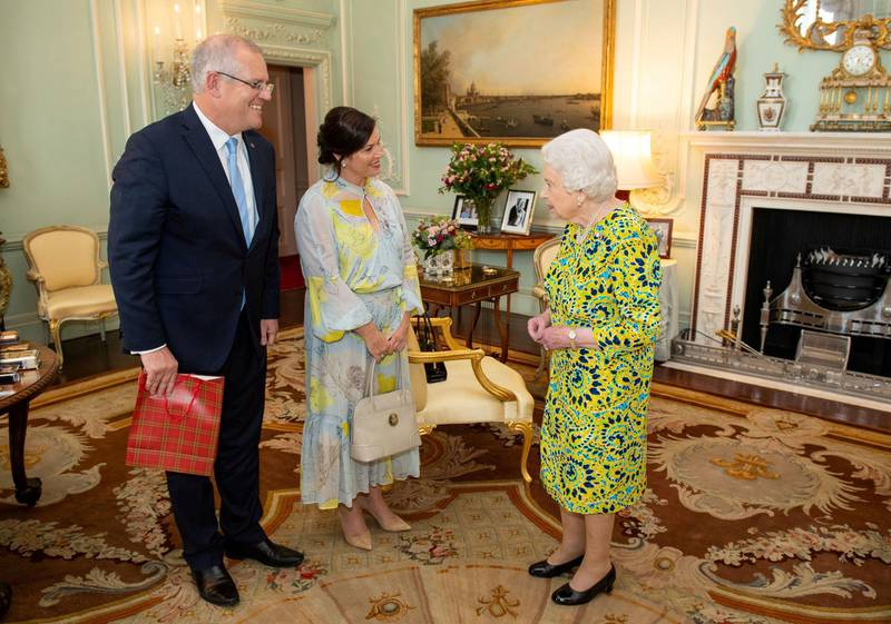 FILE PHOTO: Queen Elizabeth II meets Australian Prime Minister Scott Morrison and his wife Jennifer during a private audience at Buckingham Palace, in London, Britain June 4, 2019. Dominic Lipinski/Pool via REUTERS/File Photo