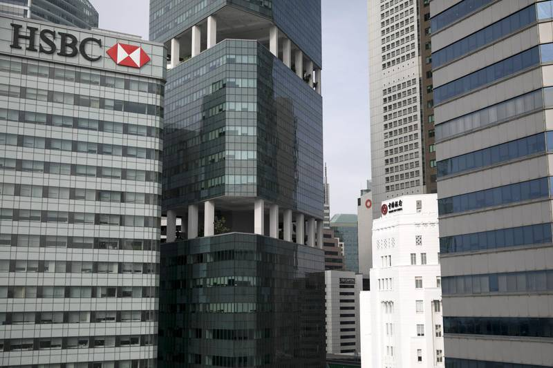 The HSBC Building, left, stands next to commercial buildings in Singapore, on Monday, June 11, 2018. PresidentDonald Trumpis about to see whether his bet on North Korea will pay off: thatKimJong Un's desire to end his country's economic strangulation and pariah status will prevail over the dictator's fear of relinquishing his nuclear threat.  Photographer: Brent Lewin/Bloomberg