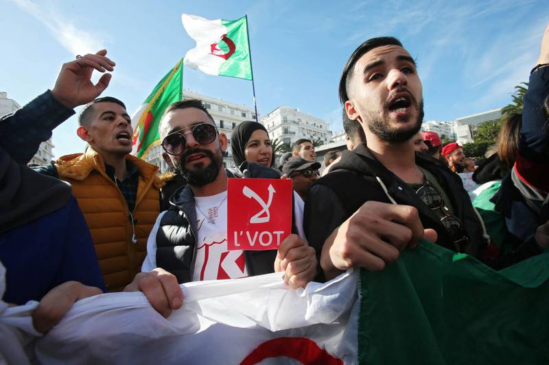 """A man holds a sign reading"""" No vote"""", during a protest rejecting the presidential election in Algiers, Algeria December 11, 2019. REUTERS/Ramzi Boudina"""