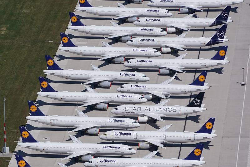 SCHOENEFELD, GERMANY - JUNE 01: Passenger planes of airline Lufthansa that have been temporarily pulled out of service stand parked at Berlin-Brandenburg Airport during the coronavirus crisis on June 01, 2020 in Schoenefeld, Germany. Countries across Europe are easing lockdown measures and many are seeking to promote a return of international travel and tourism. At the same time airlines are still facing a calamitous era, with some already receiving government bailouts and many announcing layoffs.   (Photo by Sean Gallup/Getty Images)