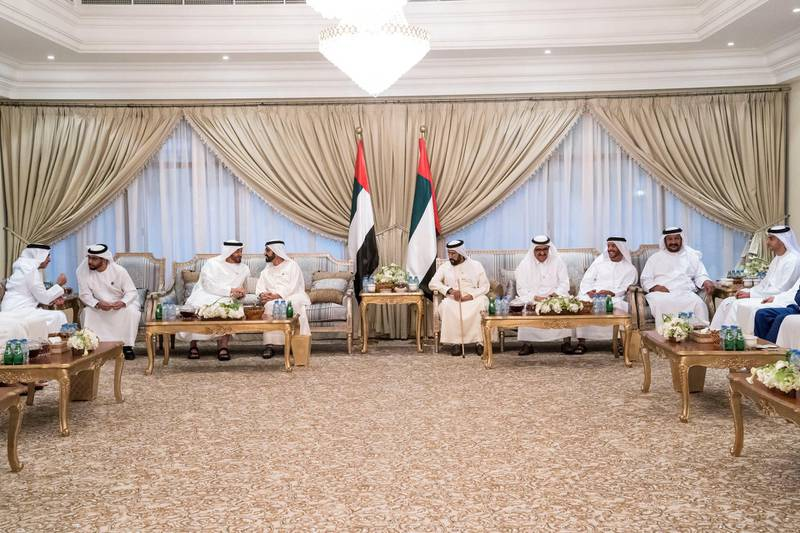 ABU DHABI, UNITED ARAB EMIRATES - June 13, 2018: HH Lt General Sheikh Saif bin Zayed Al Nahyan, UAE Deputy Prime Minister and Minister of Interior (L), HH Sheikh Hamdan bin Zayed Al Nahyan, Ruler's Representative in Al Dhafra Region (2nd L), HH Sheikh Mohamed bin Zayed Al Nahyan, Crown Prince of Abu Dhabi and Deputy Supreme Commander of the UAE Armed Forces (3rd L), HH Sheikh Mohamed bin Rashid Al Maktoum, Vice-President, Prime Minister of the UAE, Ruler of Dubai and Minister of Defence (4th L), HH Sheikh Hamdan bin Rashid Al Maktoum, Deputy Ruler of Dubai and UAE Minister of Finance (6th L), HH Sheikh Suroor bin Mohamed Al Nahyan (7th L), HH Sheikh Saeed bin Mohamed Al Nahyan (2nd R) and HH Sheikh Khaled bin Zayed Al Nahyan, Chairman of the Board of Zayed Higher Organization for Humanitarian Care and Special Needs (ZHO) (R), attend an iftar reception held by HH Sheikh Tahnoon bin Mohamed Al Nahyan, Ruler's Representative in Al Ain Region (5th L). ( Hamad Al Kaabi / Crown Prince Court - Abu Dhabi ) ---