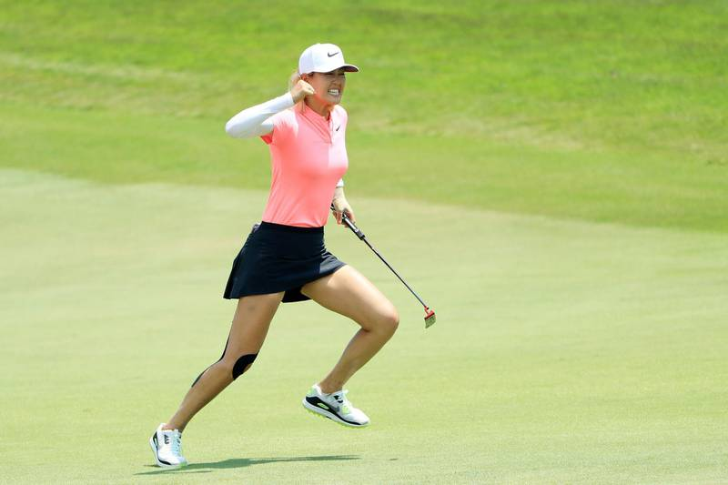 SINGAPORE - MARCH 04:  Michelle Wie of the United States celebrates her birdie on the 18th green on her way to winning during the final round of the HSBC Women's World Championship at Sentosa Golf Club on March 4, 2018 in Singapore.  (Photo by Andrew Redington/Getty Images)
