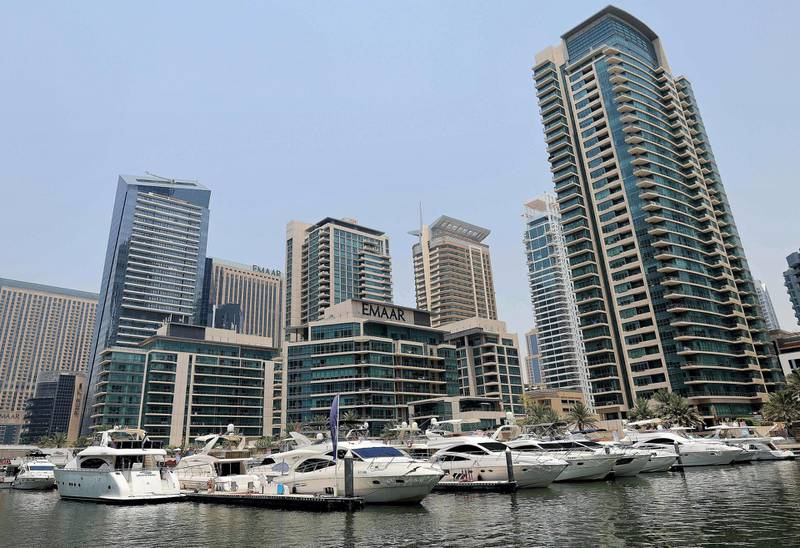 Luxury yachts are moored at the Dubai Marina Beach in the Gulf emirate, on June 10 2021.  Dubai earned a reputation for delivering luxury for those with cash to splash years ago, but amid the Covid-19 pandemic, a new mode of travel has become popular, yachts. Charter companies said they have seen an increased interest in yachting after coronavirus measures eased, especially among those who want to spend time with friends and family. / AFP / Karim SAHIB