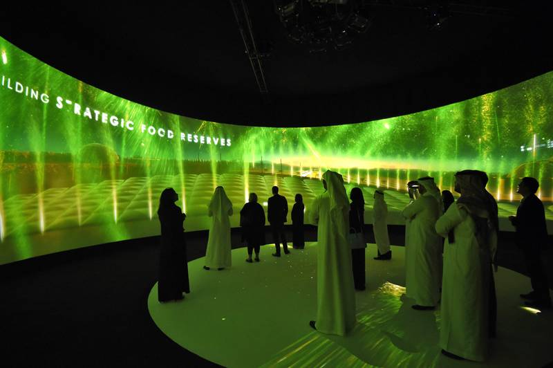 Participants watch a movie advertising Saudi's Red Sea project on the sidelines of the three-day Future Investment Initiatives conference in Riyadh, on October 25, 2017.  Saudi Arabia, smarting from a years-long oil crunch, said it aims to nearly double the assets of its Public Investment Fund by 2020 through launching a programme of investment initiatives.  / AFP PHOTO / FAYEZ NURELDINE