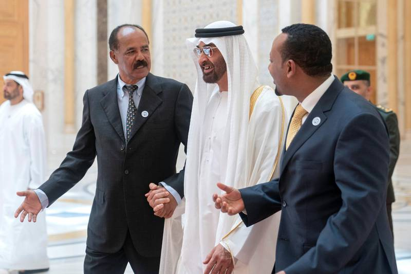 ABU DHABI, UNITED ARAB EMIRATES - July 24, 2018: HH Sheikh Mohamed bin Zayed Al Nahyan Crown Prince of Abu Dhabi Deputy Supreme Commander of the UAE Armed Forces (C), receives HE Dr Abiy Ahmed, Prime Minister of Ethiopia (R) and HE Isaias Afwerki, President of Eritrea (L), at the Presidential Palace.   ( Eissa Al Hammadi for Crown Prince Court - Abu Dhabi ) ---